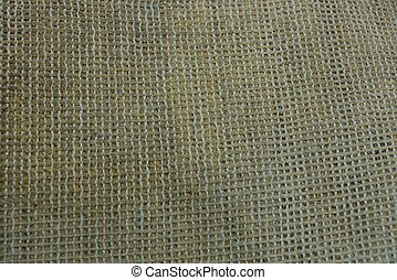 gray brown fabric texture from a piece of dirty rug