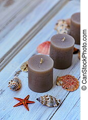 Gray candles with seashells