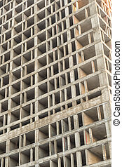gray cement building construction of an apartment building close-up vertical photo