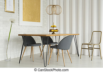 Gray chairs at wooden table