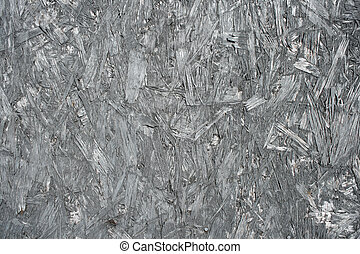 Chipboard background. Texture of gray material composed of wood shavings.
