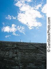 Gray concrete wall against the sky
