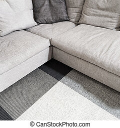 Gray corner sofa and carpet