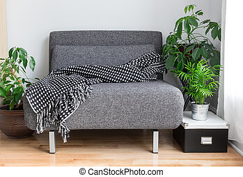 Gray fabric chair and plants in the living room - Gray ...