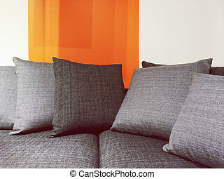 Gray fabric sofa with cushions