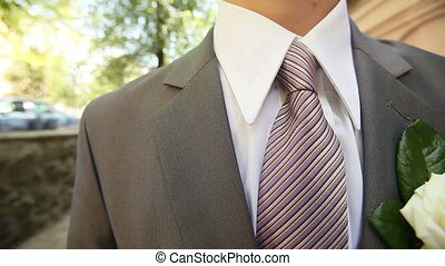 gray groom suit - groom wear gray suit with lilac tie on his...