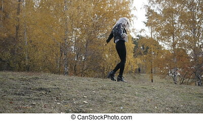 Gray-haired woman in autumn park - Pretty gray-haired woman...