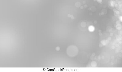 Gray motion background. Abstract glowing bokeh circles or sparks. 4K seamless loop clip