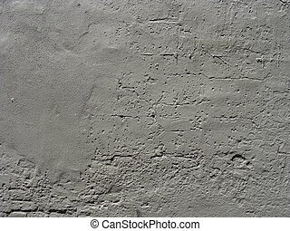 gray painted worn brick and concrete wall