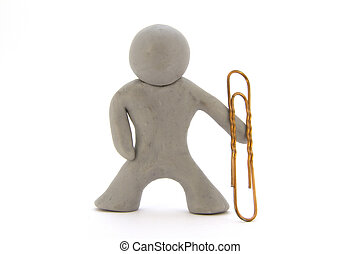 Gray plasticine character and big paperclip. Stationery. Isolated over white background