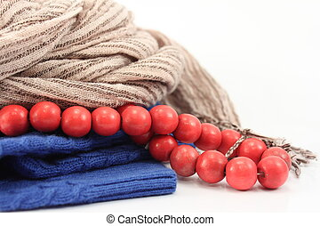gray scarf, blue hat and red beads