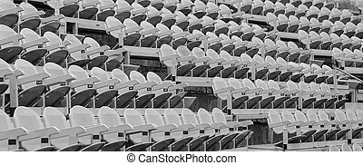 gray seats in the stands before the sporting event - gray...