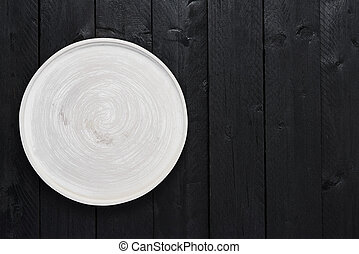 Gray serving plate on black wooden table