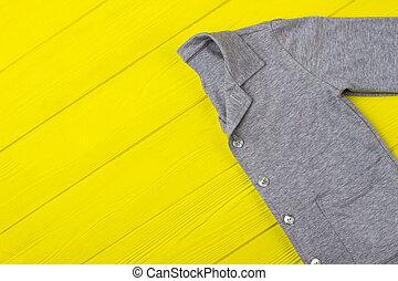 Gray shirt on yellow table