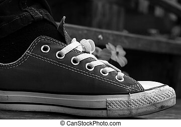 Gray shoes on a wooden floor - Sneakers.