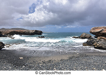 Gray Skies Over the Black Sand Stone Beach on Aruba's East Coast