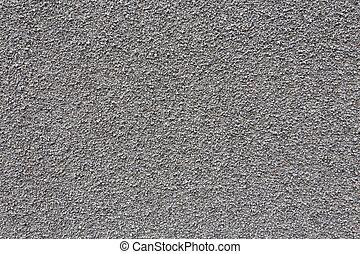 Gray small granite stone floor background texture