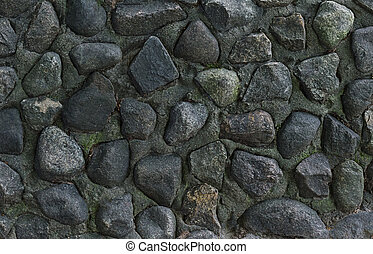 gray stone background, part of wall cobblestones in cement weather-beaten surface texture uneven