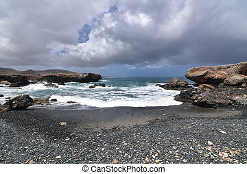 Gray Storm Clouds Above the Black Sand Beach of Aruba