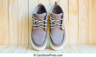 gray suede shoes on wooden background