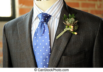 gray suit with blue tie and boutonniere