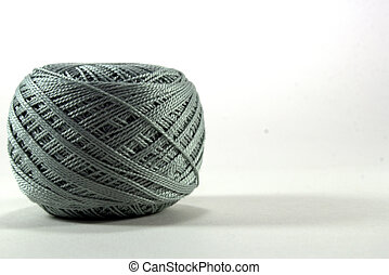 gray tangle of natural cotton thread on white background
