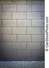 Modern gray tile wall and old sidewalk