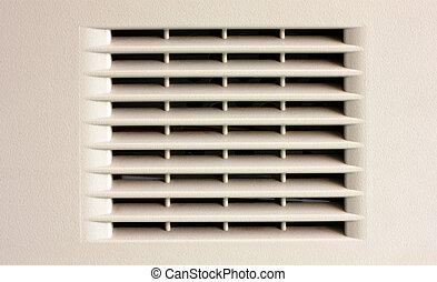 Gray plastic ventilation grille closeup view