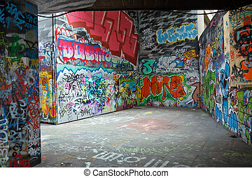 colorful graffiti - Gray walls painted with bright colorful...