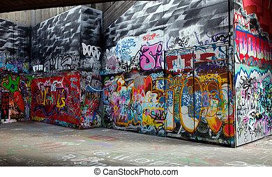 graffiti - Gray walls painted with bright colorful graffiti