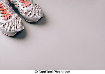 Gray woman sneakers on light gray background