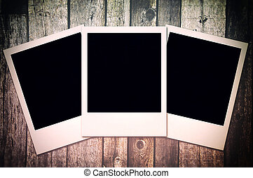 Gray wooden background with camera film