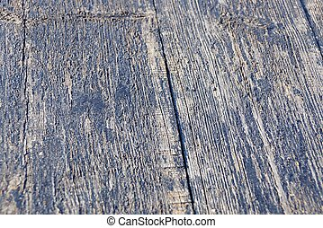 gray wooden texture of black crack on the board in the wall