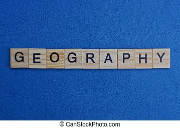 gray word geography from small wooden letters