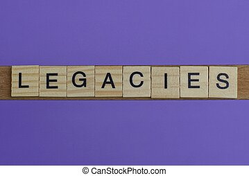 gray word legacies in small square wooden letters