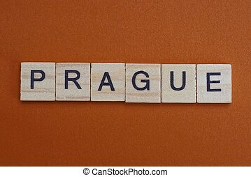 gray word prague made of small wooden letters