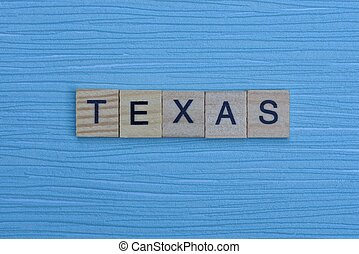 gray word texas from small wooden letters