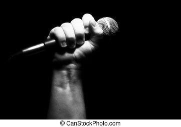 Grayscale Microphone in Fist - Grayscale Microphone Clinched...