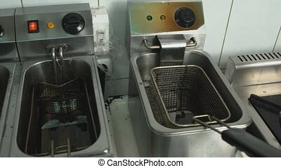 greasy dirty Deep fryers are in a kitchen restaurant cafe,...