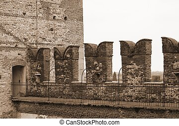 great battlements of the castle on the walls to protect the medieval soldiers
