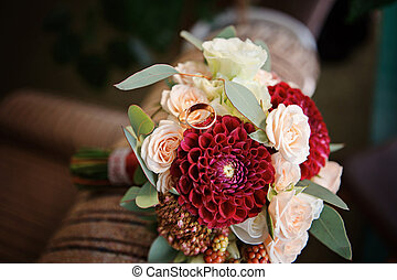 Gold wedding rings on a bouquet