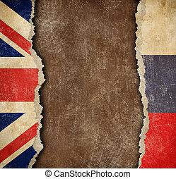 Great Britain and Russian torn paper flags. Break of diplomatic relations.