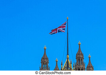 Great Britain flag on Victoria Tower of Palace of Westminster. London