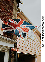 Great Britain flag on wall of historic building