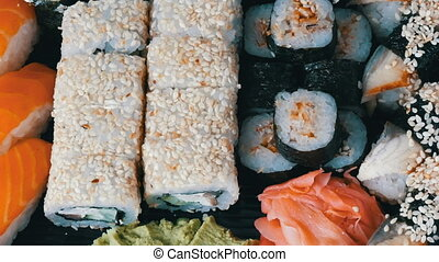 Great choice Variety of sushi roll, nigiri, maki, Gunkan with salmon, eel, shrimps, Philadelphia cheese and other national Japanese cuisine close up