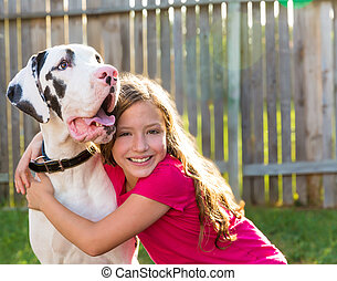 great dane and kid girl hug playing outdoor - great dane and...