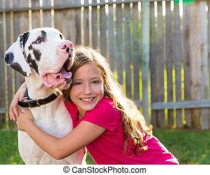 great dane and kid girl hug playing outdoor - great dane and...