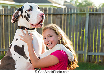 great dane stand up on kid girl shoulders playing together
