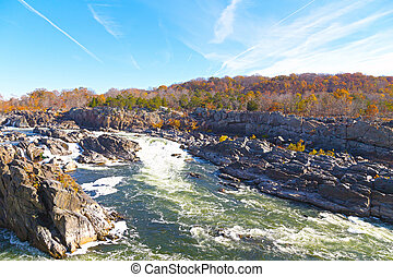 Great Falls National Park in autumn, Virginia USA. Potomac river with rocky banks and colorful autumn trees.