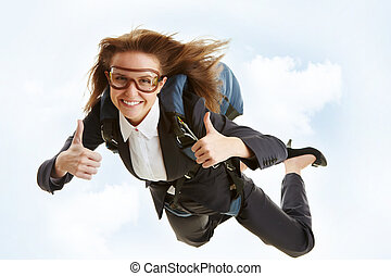 Great flight - Conceptual image of young female flying with...